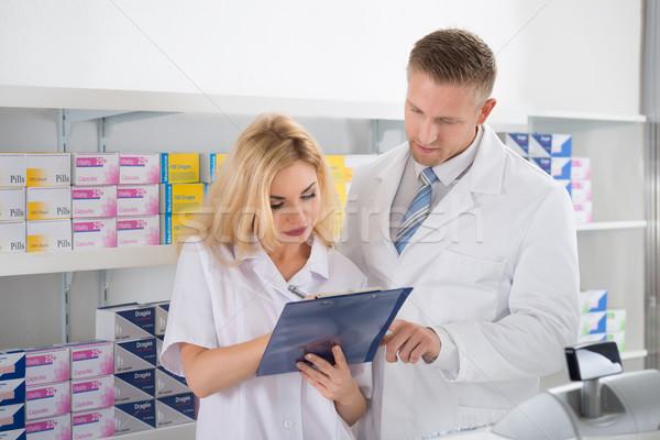 Pharmacists Maintaining Checklist In Pharmacy Stock photo © AndreyPopov