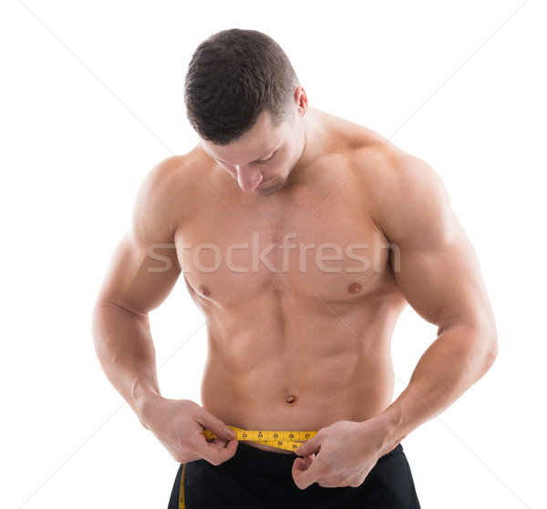 Muscular Man Measuring Waist With Measure Tape Stock photo © AndreyPopov
