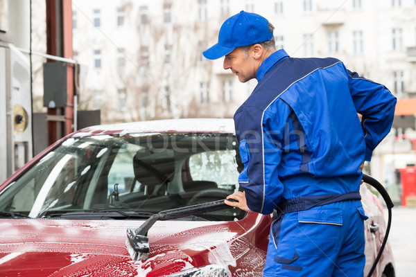 Manual Worker Washing Car At Service Station Stock photo © AndreyPopov
