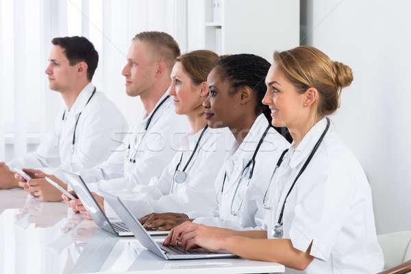 Doctors Using Laptop In Meeting Stock photo © AndreyPopov