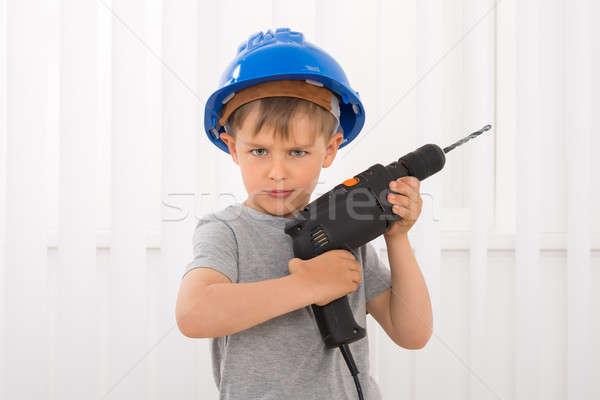 Portré fiú tart elektromos fúró védősisak Stock fotó © AndreyPopov