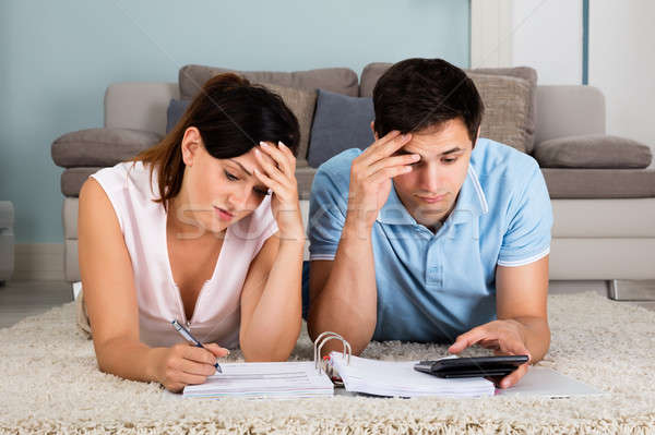 Unhappy Couple Calculating Bills Stock photo © AndreyPopov