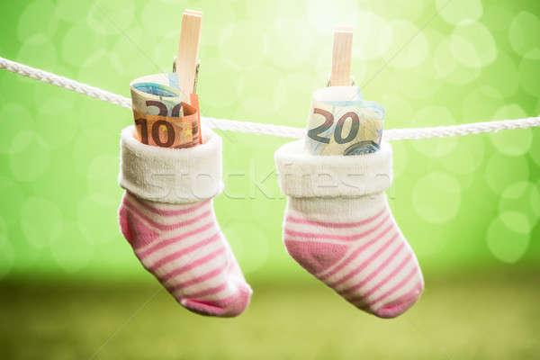 çift bebek çorap dolar asılı halat Stok fotoğraf © AndreyPopov