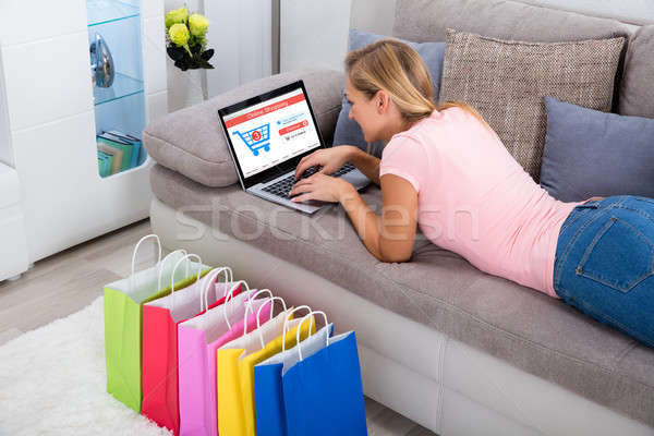 Woman Using Laptop For Online Shopping At Home Stock photo © AndreyPopov