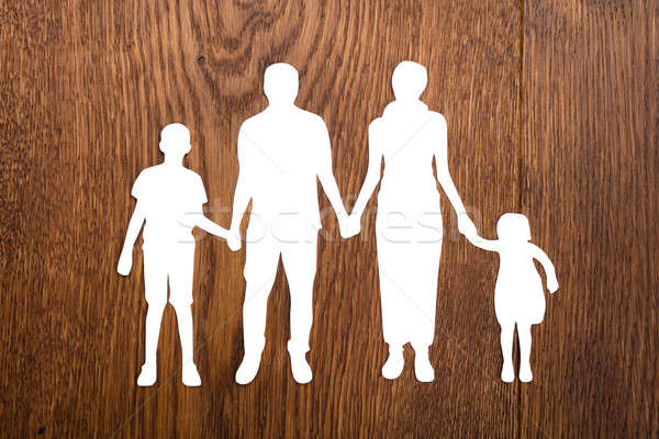 Family Papercut On Wooden Desk Stock photo © AndreyPopov