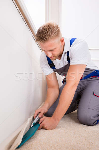 Person Cutting Carpet With Cutter Stock photo © AndreyPopov