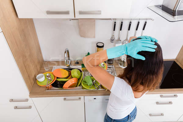 исчерпанный женщину Постоянный кухне молодые Сток-фото © AndreyPopov