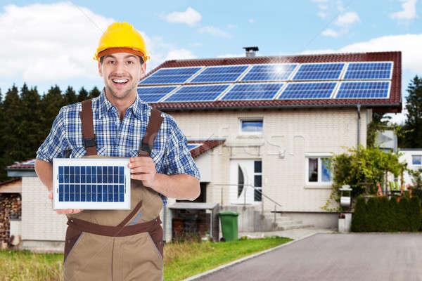 Stock photo: Repairman Holding Solar Panel