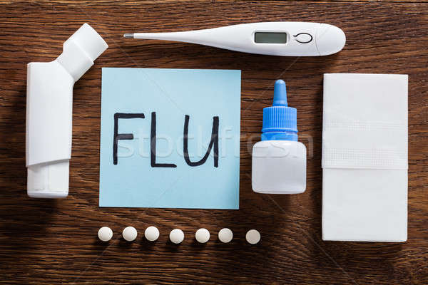 Flu Concept On Wooden Desk Stock photo © AndreyPopov