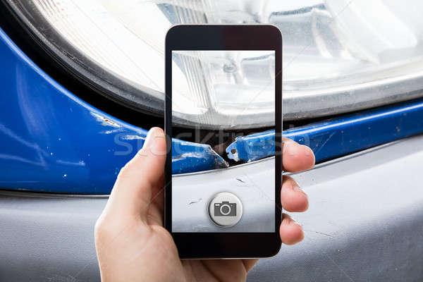 Personne photos endommagé voiture Photo stock © AndreyPopov