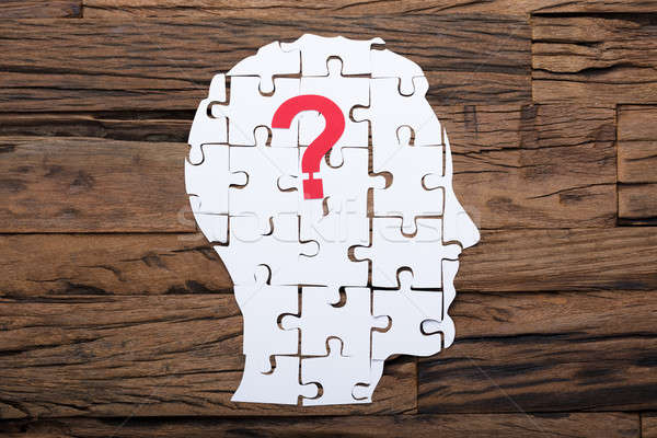 Head Made From Paper Jigsaw Puzzle And Question Mark Stock photo © AndreyPopov