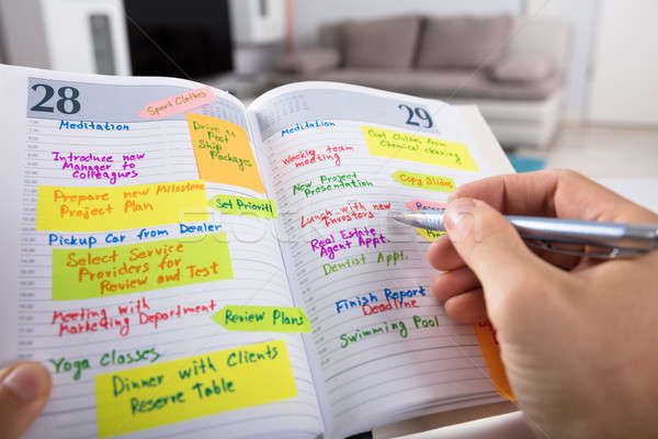 üzletember ír menetrend napló közelkép kéz Stock fotó © AndreyPopov