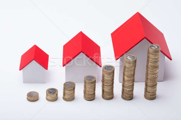 Different Size Houses With Stack Of Coins Stock photo © AndreyPopov
