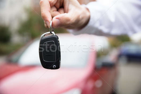 Person's Hand Holding Car Key Stock photo © AndreyPopov