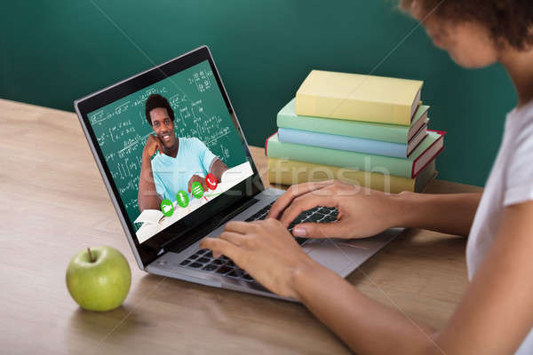 Student Video Conferencing With Teacher On Laptop Stock photo © AndreyPopov
