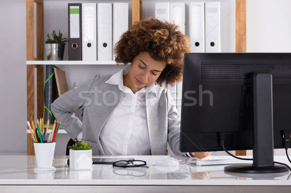 Businesswoman Suffering From Backache Stock photo © AndreyPopov