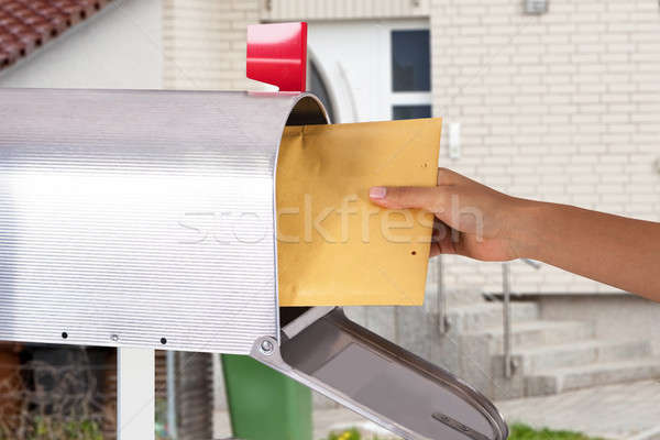 Person Removing Letter From Mailbox Stock photo © AndreyPopov