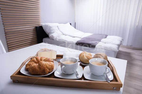 Croissants And Cup Of Tea In Tray Stock photo © AndreyPopov