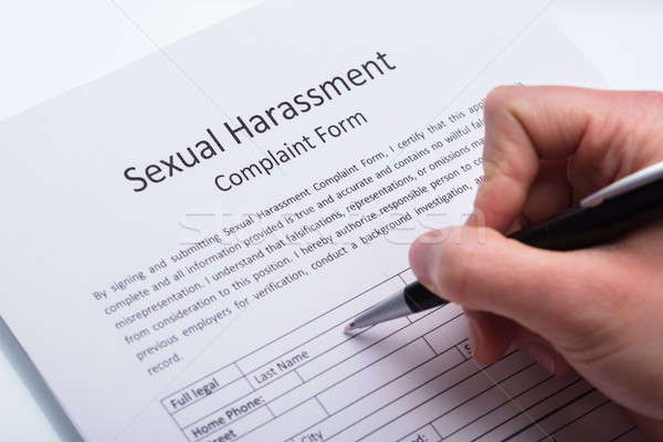 Human Hand Filling Sexual Harassment Complaint Form Stock photo © AndreyPopov
