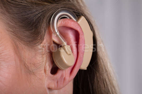 Stock photo: Woman With Hearing Aid