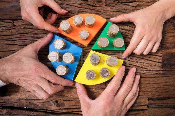 üzletemberek érmék kördiagram színes fából készült asztal Stock fotó © AndreyPopov