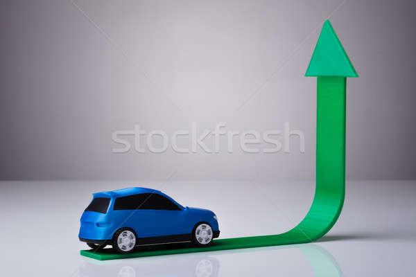 Blue Car Driving On Green Upward Arrow Stock photo © AndreyPopov