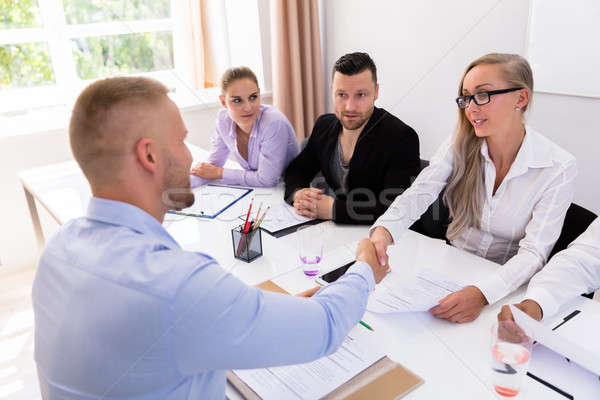 Businessman Shaking Hands At Interview Stock photo © AndreyPopov