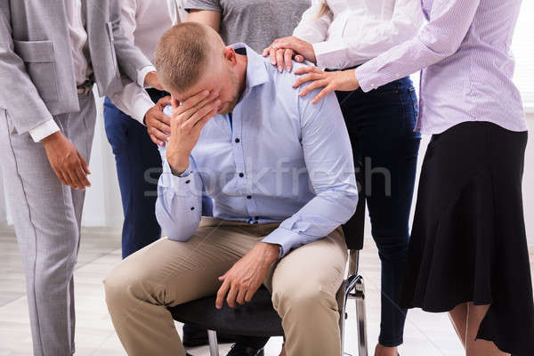 Group Of People Consoling Upset Man Stock photo © AndreyPopov