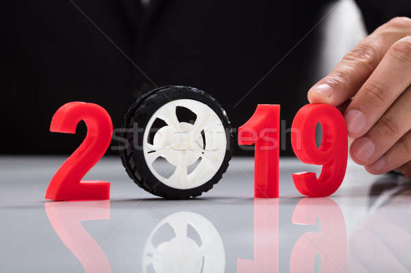Businessperson touching 2019 year Stock photo © AndreyPopov