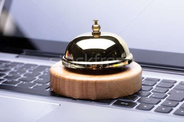 Közelkép arany szolgáltatás harang laptop numerikus billentyűzet Stock fotó © AndreyPopov