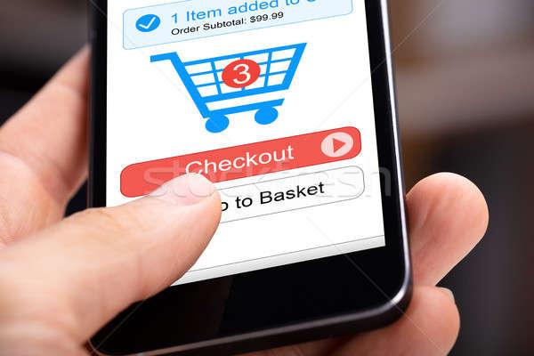 Stok fotoğraf: Kişi · online · alışveriş · uygulama · insan · eli · cep · telefonu