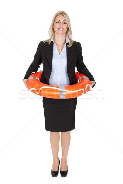 Mooie zakenvrouw reddingsboei geïsoleerd witte vrouw Stockfoto © AndreyPopov