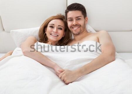 Paar bed samen portret liefhebbers Stockfoto © AndreyPopov