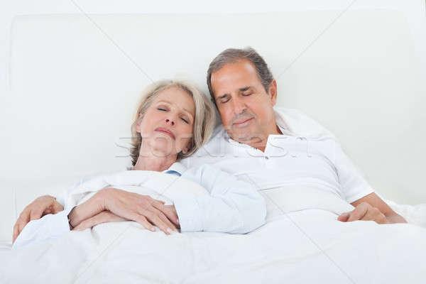 Happy Senior Couple On Sleeping Bed Stock photo © AndreyPopov