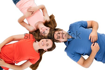 Four friends facing in with their heads together Stock photo © AndreyPopov