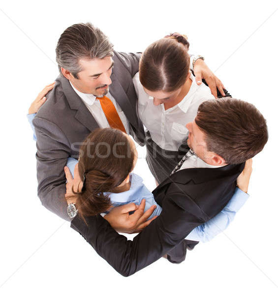 Huddle Of Businesspeople Stock photo © AndreyPopov