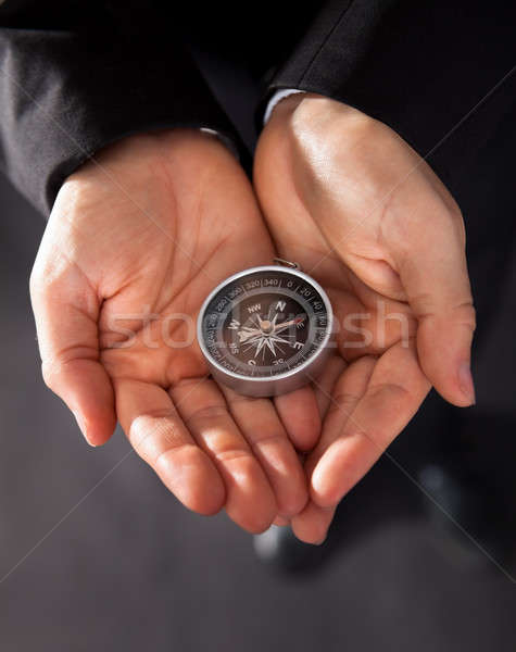 Businessman looking at a compass Stock photo © AndreyPopov