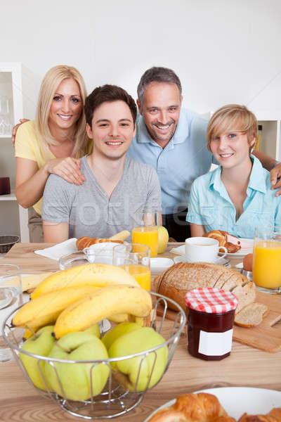 Mutlu aile kahvaltı iki çocuklar Stok fotoğraf © AndreyPopov