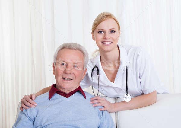 Portrait Of Happy Doctor And Patient Stock photo © AndreyPopov
