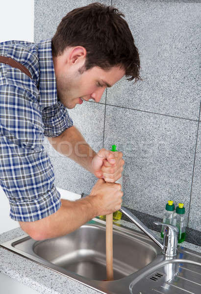 Young Man With Plunger Stock photo © AndreyPopov