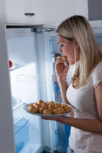 Young Woman Eating Cookies Stock photo © AndreyPopov