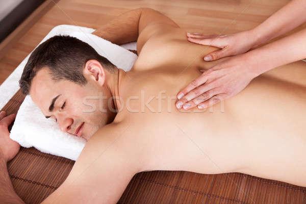 Młody człowiek ramię masażu wesoły spa dziewczyna Zdjęcia stock © AndreyPopov