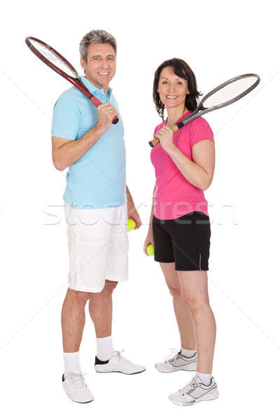 Mature couple with tennis racquets Stock photo © AndreyPopov