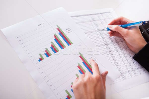 Stock photo: Woman working with bar graphs