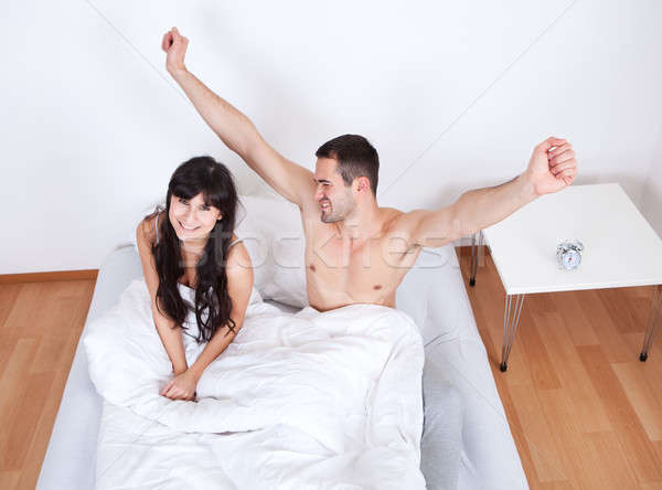 Couple waking up in bed Stock photo © AndreyPopov