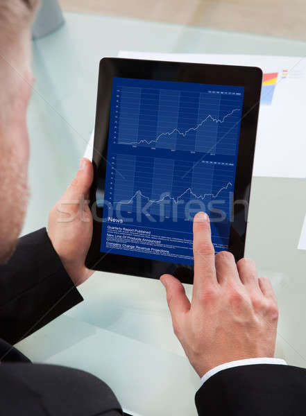 Businessman navigating on his tablet-pc Stock photo © AndreyPopov