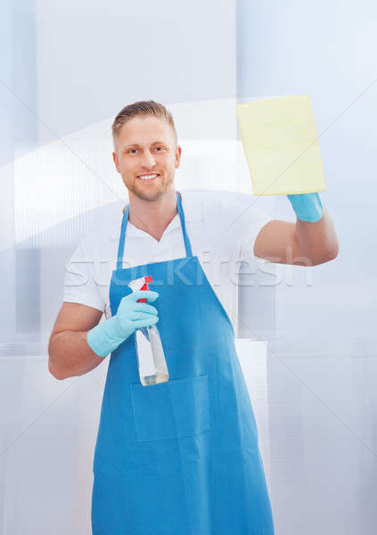 Cleaner cleaning a pane of glass Stock photo © AndreyPopov