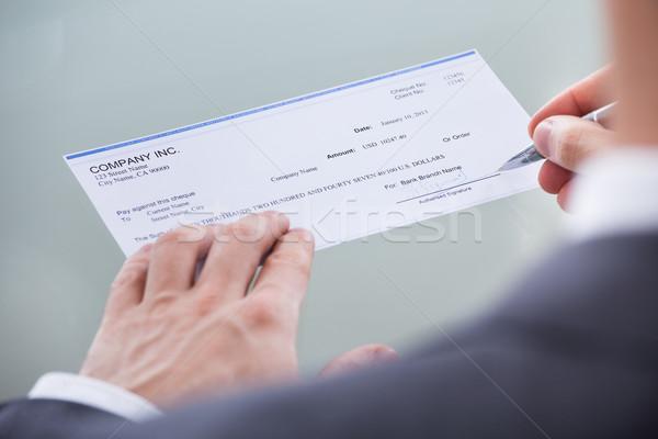 Homme d'affaires signature argent chèque stylo Photo stock © AndreyPopov