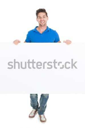 Adam bakıyor ilan panosu tam uzunlukta genç yalıtılmış Stok fotoğraf © AndreyPopov
