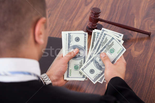 Judge Counting Dollars In Courtroom Stock photo © AndreyPopov